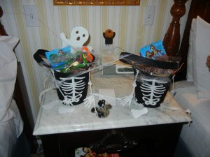 Treat baskets in our room, and a projectable haunted house that shone a haunted house on our ceiling!