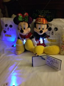 Mickey Mouse and Minnie Mouse all dressed up for Halloween in July!